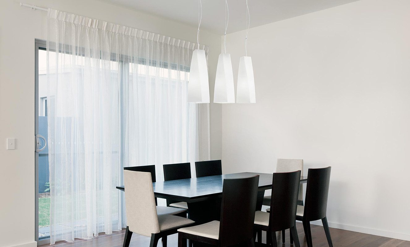 modern Pendant Lights above a dining table